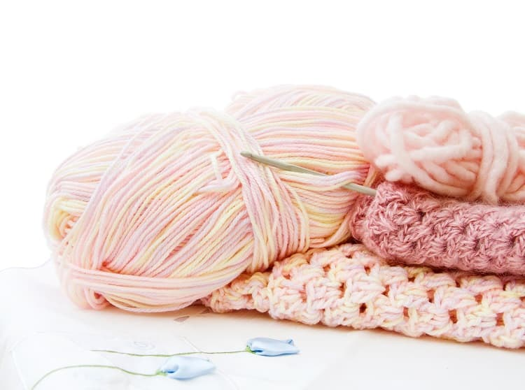 Crochet and yarn in pink